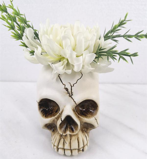 Artificial plant in skull flower pot
